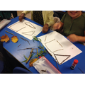 We loved using the sticks to make shapes.