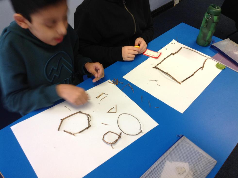 """""""Hexagons have six sides."""" say Azaan and Zac."""