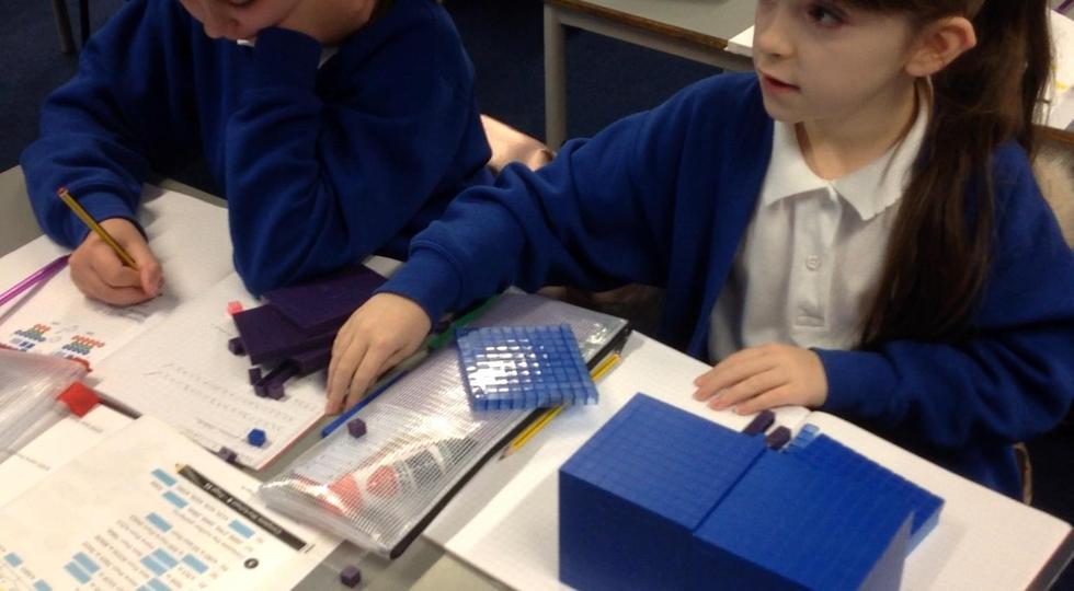 Using practical resources to work out tricky sums.