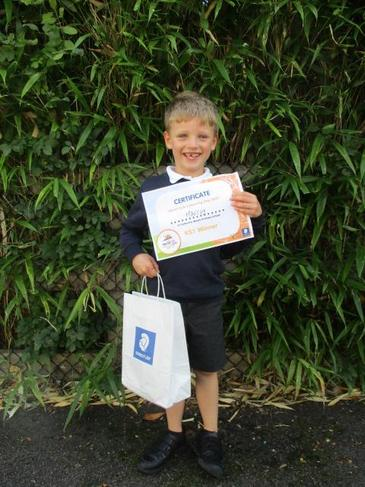 Our very proud winner with his goodie bag and certificate