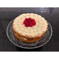 Darcey cake decorated with white chocolate and raspberries - delicious!