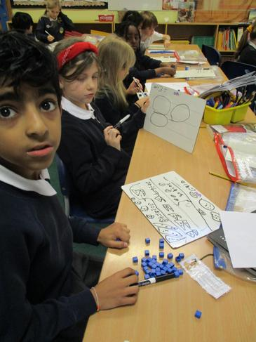 Working hard with the Dienes blocks to help with place value