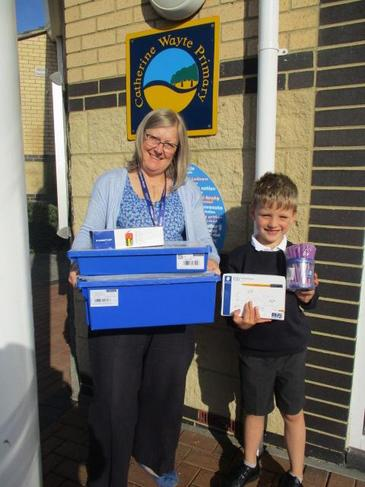 Harry helped Mrs Wheeler unpack the school prize