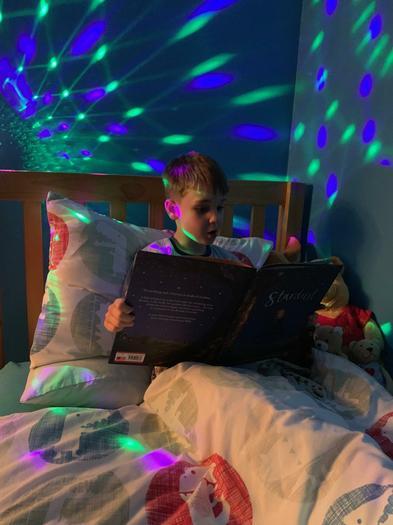 Alfie enjoying reading under the stars.
