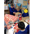 We found it very hard to cut cardboard but persevered well!