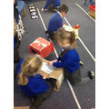 We worked hard to cut out the box to create the shape of a basket for our pretend doggies!