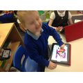 We know how to turn on the iPad and choose the game '2Simple Story'.