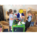 Home-corner role-play. A very busy household!