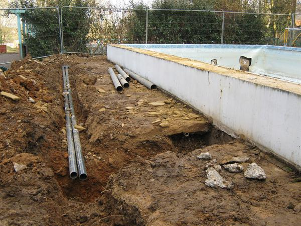 trenches along side of pool for improved pipework