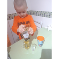 Luca is making a drink for his tea party