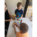 Iulian enjoying the lego game with his siblings