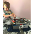 Alexandru is building with Lego