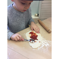 Spreading tomato puree