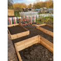 Filling the beds with compost