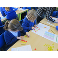 Learning to find fractions of numbers.