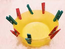 Pegging- Place pegs around a bowl and take off