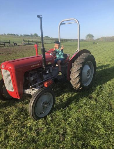Fletcher learning to drive a Massey 35 tractor!