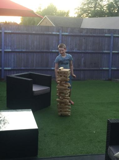 Zach's jenga is almost as tall as him!