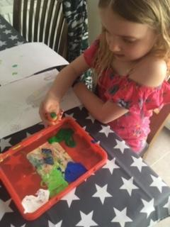 Millie doing some vegetable painting