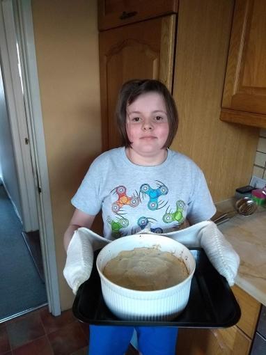 Louise making dinner