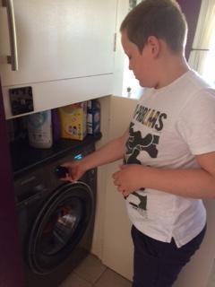 Joss using the washing machine