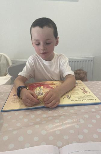 Jack reading his science book