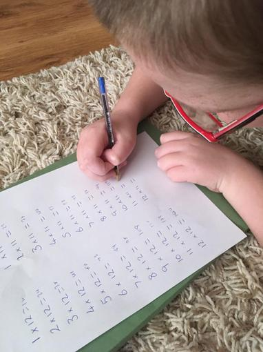 Ollie continuing to work hard on his times tables!