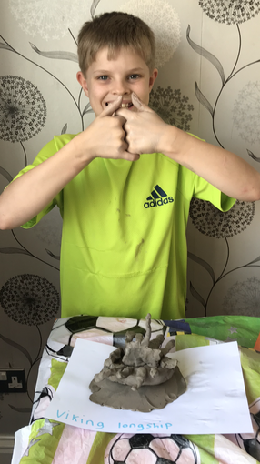 Max has been busy crafting a clay Viking ship...