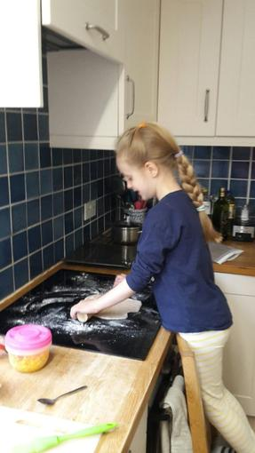 Niamh making pizza