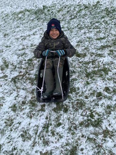 Fletcher making the most out of his sledge during the Sunday snow!