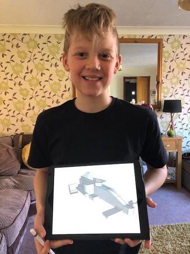 Alex designing his formula one car!