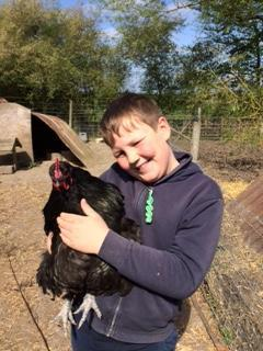 Joss and one of his favourite chickens!