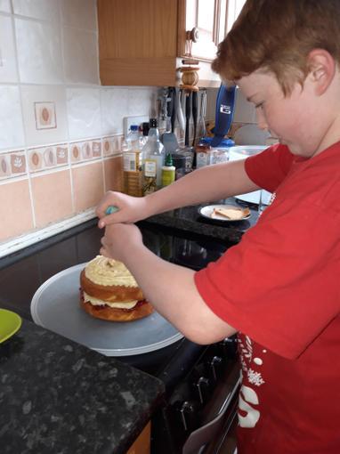 Ben icing his cake