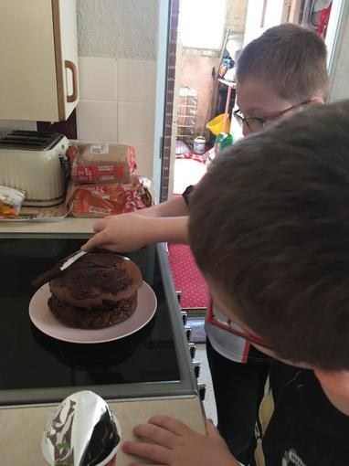 Ollie's been making a b-day cake for his brother!