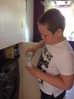 Joss loading the washing machine