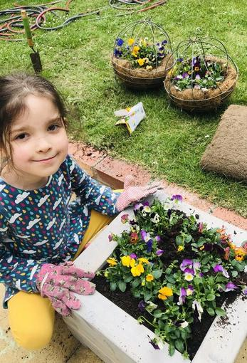Isabelle helping in the garden