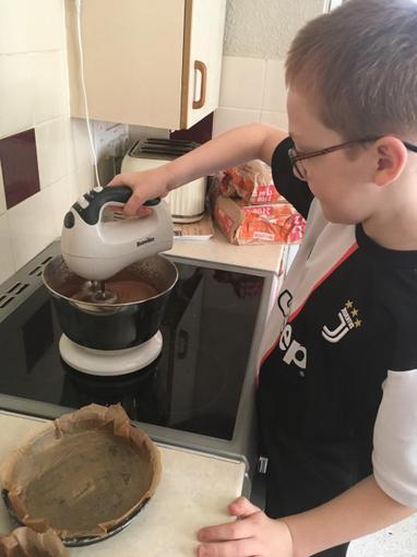 Ryan making his brothers birthday cake! Yum!
