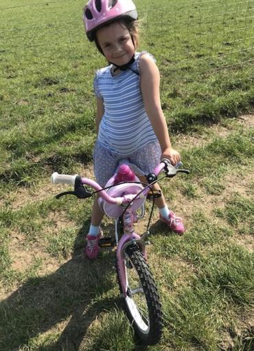 Fleur on her bike