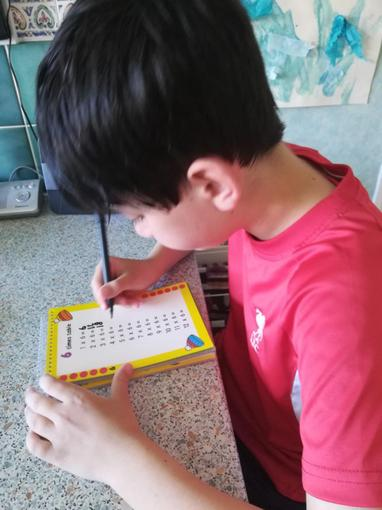 Jack furiously practising his times tables...