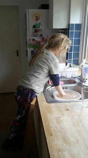 Niamh washing the dishes!