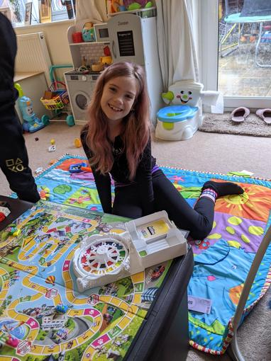 Lyssy enjoying tsome games with her family...
