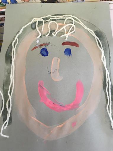 We painted our self portraits. Here is Mrs Thompson!