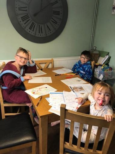 Josh hard at work with his siblings!
