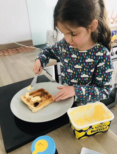 Isabelle making toast