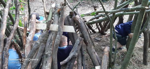 Teamwork building a Den for all.