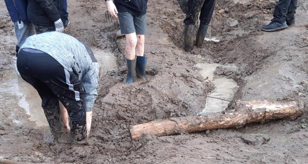 Ankle deep in mud - why wellies are a must!