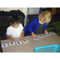 Year One collaboratively ordering jumbled numbers