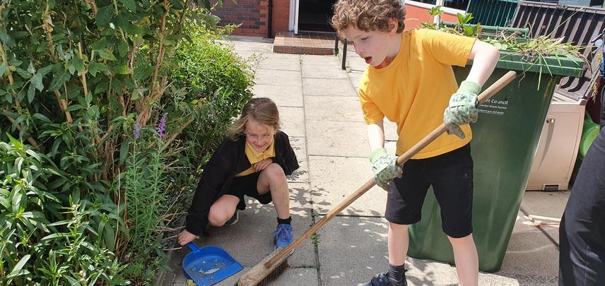 A number of children like to work in the garden at lunchtimes.