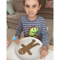 Decorating a gingerbread man
