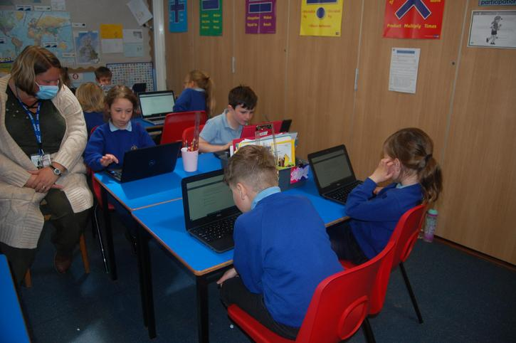 Children use laptops to support their learning across the curriculum.